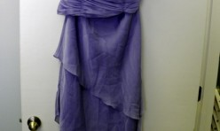 Lavender gown with asymmetrical skirt and ruched bodice Size 14